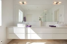 white bathrooms, my favorites...but imagine keeping that clean.