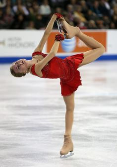 (Elena Radionova Photos - 2014 Hilton HHonors Skate America - Zimbio). what is this crazy contraption???????