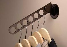 Closet Folding Valet Rod. This works great with tiny houses or any home that has shallow storage issues. It folds down and flattens the clothes against the wall, but makes it easy to pull up and rummage through.