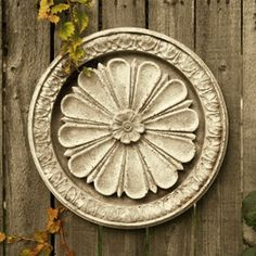 Abbott Medallion 15 diameter Architectural Fiberstone 15.0 W 2.0 D 15.0 H Shown in the Cathedral White surface All products are hand made to order and