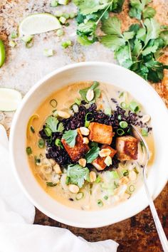 Thai ginger and lemongrass infused soup with crispy tofu and wild rice. Easy to decrease oil and use lower fat coconut milk if you like.