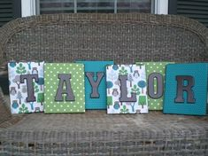 scrapbook covered canvases with painted chipboard letters.