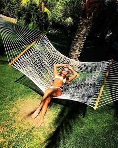 Lea Michele lounging in a Solid & Striped bikini