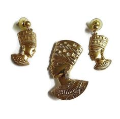 "This is a wonderful Vintage 1980's AVON Nefertiti Brooch / Pendant & Earrings Set Egyptian Revival!  The brooch / pendant measures 2 1/4"" long by 1 1/2"" wide.  To wear as a... #teamlove #ecochic #vogueteam"