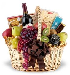 Elegance to Spare Fruit Gourmet Wine Gift Basket. When first impressions really count, the classic combination of fruit, gourmet, and wine will really turn heads. We use fresh fruits (domestic and exotic), combine them with delicious gourmet treats, and top it off with a bottle of Cabernet Sauvignon, Chardonnay, or both. Of course, we wrap it in colored cellophane and top it with a bow to finish the show! Exact basket and fruit/gourmet selection may vary by season and delivery location. Due…