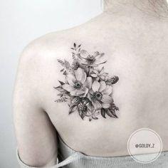 Flowers tattoo by Zlata Kolomoyskaya