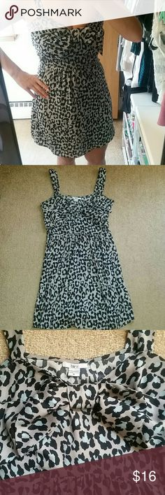 Snow Leopard Bow Dress So cute wished it fit! Gray dress with blue leopard print all over. Bow front. Side zip. This fabric has no stretch and runs small in the chest. Great condition no rips or stains. Bar III Dresses