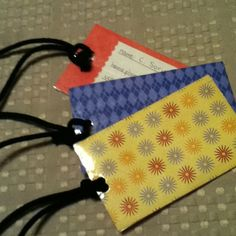 DIY luggage tag: scrapbook paper, clear packing tape, rope or string, glue, and scissors are all you need!