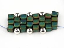 How to Embellish Peyote Stitch.  In this example there is one silver bead per stitch.  Other things, like daggers, could be added. #seed #bead #tutorial