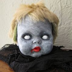 Turn and old doll head into a creepy Halloween decoration. --made me think of you @Laurel Wypkema Yando you and your dead dolls lol
