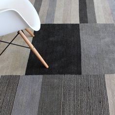 Charcoal tones in this striped wool rug. | The Rug Establishment