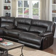 modern black leather sectional sofa with chaise and round coffee