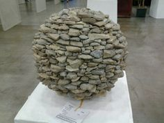Garden art. An old bowling ball, grout and rocks. How easy.