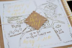 Map Wedding Invitation Kraft Paper and Yellow Calligraphy for Urban Rooftop Picnic Wedding Theme Ideas ph. Catie Ronquillo Photography