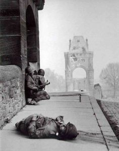 American soldiers under fire from a German sniper on the Nibelungen Bridge in Regensburg after one of their comrades was killed (April 1945). On April 23, 1945, German forces blew up the bridge to slow the Allied advance.