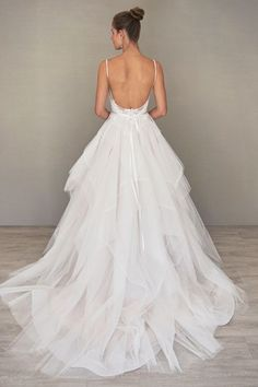"""Ivory / Cashmere tulle and lace bridal ball gown with a sheer """"V"""" neckline and low ballerina scoop back. Thin satin ribbon at the natural waist and a horsehair edged flounce skirt with shimmer throughout."""