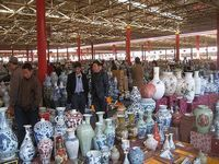 Would you like to try to go shopping in Beijing? The pre-designed Beijing shopping tour is divided into two parts including Beijing shopping tour to antique markets and Beijing shopping tour to clothing markets.