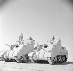 Grant and Lee tanks of 'C' Squadron, 4th (Queen's Own) Hussars, 2nd Armoured Brigade, El Alamein position, Egypt, 7 July 1942.
