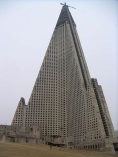 Ryugyong Hotel, N. Korea. Construction began in 1987 and halted in 1992 due to outrageous building costs. Abandoned for many years, an Egyptian company is attempted to complete the work, but whether or not the building is even stable after so many years of weather and neglect, remains to be seen.