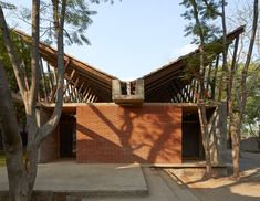 A Buddhist learning centre amongst rural groves Exterior facade and building of 'Jetavan' – a buddhist skill development center captured by Edmund Sumner. Tropical Architecture, Brick Architecture, Vernacular Architecture, Architecture Awards, School Architecture, Sustainable Architecture, Sustainable Design, Amazing Architecture, Contemporary Architecture