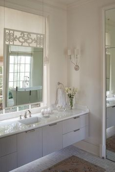 Bathroom Vanity Under Window lovely bathroom features a custom double vanity topped with honed