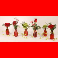 BOTTLES OF CHEER:  Our 6 red budvases are an adorable way to decorate your table. If you are looking for a centerpiece but don't want to take up a lot of room, these little guys are perfect!  #MatlackFlorist