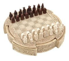"""Viking Chess Game-The NorseAmerica miniature Viking Isle of Lewis Chess set is a high quality replica of authentic 900-year-old chess pieces. The Lewis chessmen are the most famous chess pieces in history. In every way possible, this quality replica is designed to maintain the integrity of the hand-carved walrus-tusk originals. Made in from a crushed-stone and polyester-resin compound, these chess pieces look and feel like the ancient set. The pieces measure between 1 1/4"""" and 1 3/4"""" tall…"""