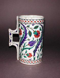 Maker:    Unknown; potter    Category:    fritware (stonepaste)    Name(s):    tankard  Islamic pottery; category  Iznik; category    Date:    circa 1575 — circa 1585    School/Style:    Ottoman    Period:    late 16th Century