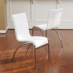 @Overstock - Invite a great contemporary flair into your home with these white modern chairs. A set of two chairs with graceful lines and chrome legs, these are made from PVC for ease of cleaning and durability. They are 35.03 H x 17.52 W x 22.44 D.http://www.overstock.com/Home-Garden/Christopher-Knight-Home-Kensington-White-Modern-Chairs-Set-of-2/6504313/product.html?CID=214117 $153.79