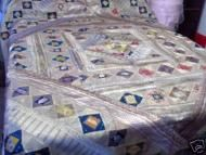 Price $145.00 - Handmade   You are looking at a beautiful patchwork bedspread made in India, inshimmering Silverwith bright patches of color. The quilt top is made from strips ofsari silk brocade, alternated with bright complimentary colorful pieces of silk fabric. It is pieced togetherin a striking diamond pattern....