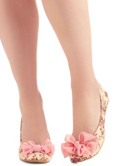 Sweet floral flats with fluffy pink bows