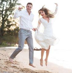 Jumping for joy:Natalie Zea shared a photo from her Hawaiian beach wedding to Scrubs acto...