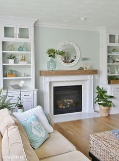 Kitchen Living Rooms Remodeling Coastal Familyroom with Builtins and Wood Beam Fireplace .paint=Seasalt sherwinwilliams - After a house flood which destroyed the kitchen and family room, come see this beautiful coastal family room and fireplace makeover. Living Room Decor Fireplace, Home Fireplace, Fireplace Design, Fireplace Ideas, Farmhouse Fireplace, Fireplace Doors, Beach Fireplace, Fireplace Frame, Fireplace Mantels