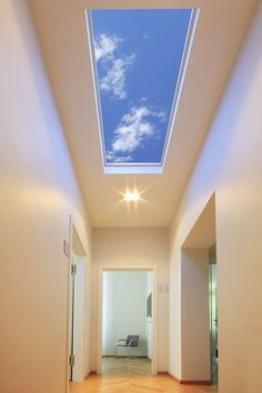 This stunning virtual skylight transforms interior hallways and other interior spaces into pleasant through ways by providing a pleasant connection to perceived open sky. Provide a visual connection to nature with Sky Factory's virtual skylights, Luminous SkyCeilings.  #artificialskylight #virtualskylight #ledskylight #fakeskylight #bathroomdesignvirtual