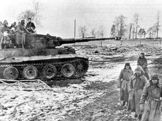 Tiger 1 nr. 123 of Schwere Panzer Abt. 505 providing cover for some weary soldiers