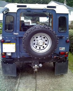 Split tailgate on a Defender - made using a pickup drop-down tailgate and the top half of a Defender door.