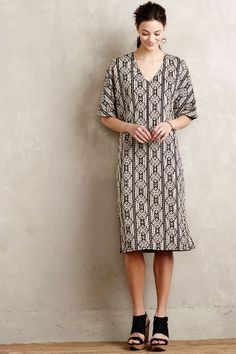 Rosolina Midi Dress - anthropologie.com Forgiving and modern shape on this dress- for when you don't want a body conscious style.