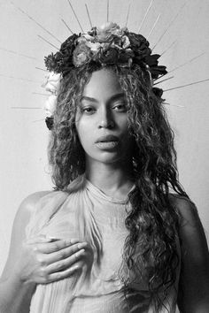 Pretty much breaking the internet with the announcement of her pregnancy with twins, Beyoncé posted images to Beyonce.com with her hair worn in natural curls topped with a flower crown.