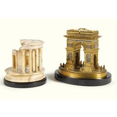 Works of Art from the Collection of GIANNI VERSACE - Villa Fontanelle, Moltrasio /// An ITALIAN GRAND TOUR MARBLE MODEL of THE TEMPLE OF VESTA, ROME, circa 1880 ; together with a gilt-bronze and silvered model of the Arc de Triomphe, circa 1900 ; the hinged lid with a silk lined interior on an oval black marble base. - Dim. : Temple of Vesta: 11.5 cm. high; 4½in. Arc de Triomphe: 15cm. high; 6in.