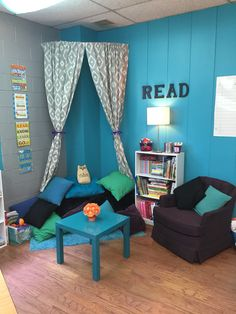 classroom reading nook     -curved shower rod  -curtains and shelves from Target  -small arm chair and lamp from garage sale  -various pillows  -teal rug and bean bag chairs from Walmart  -black letters from Michaels  -table from IKEA  -Dr. Suess quote posters from Target $1 Spot