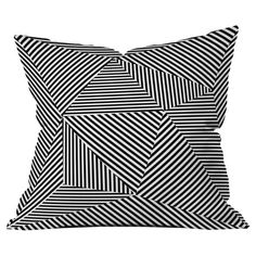 A geometric-chic touch for your sofa, settee, or chaise, this boldly printed pillow features a patchwork of stripes running at many angles. Made in the USA. ...
