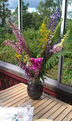 ceramic jars and wildflowers