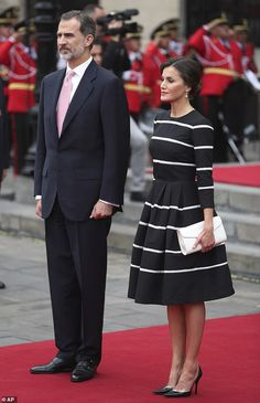 Letizia, 46, opted for astriped fit-and-flare dress as she and husband Felipe arrived in ...