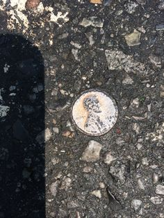 Penny imbedded in street.