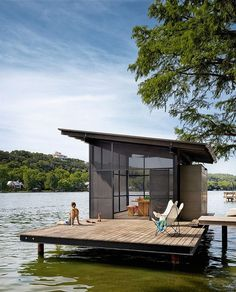 Love this modern sunroom on the dock.