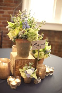 love the idea of using wooden boxes... and love the clusters of candles....