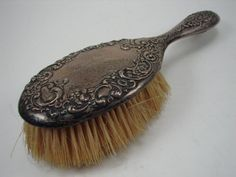 """Sterling silver Victorian hair brush, 9 1/2"""" long, offered by liveauctioneers."""