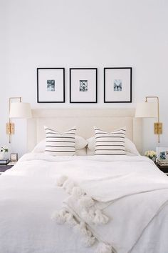 My top pins this week - Alaina Kaz beautiful white bedroom with striped pillows