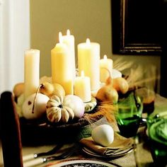 White candles arranged of different heights and assortment of pears and white squash ! Simple Elegance