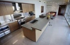 polished concrete kitchen floor, timber finish cupboards